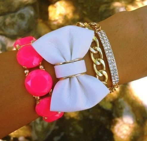 Love this combination of bracelets - bow, chain, chunky, pink, white, gold