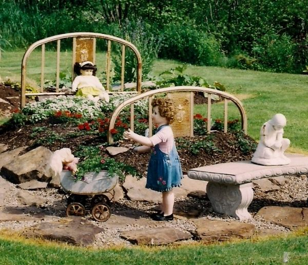 I want to do this in my back yard! Flower bed made from an old bed frame.