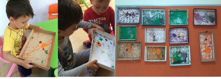 Çocuklar ayakkabı kutusu kapağına istedikleri gibi parmak boyasını döküp, misketi kapağın içinde yuvarladılar. 4 yaş için denge ve soyut sanat çalışması.