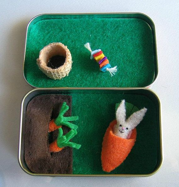 With this Bunny Rabbit garden play set you can actually plant the carrots for this little bunny.  My little bunny rabbit measures 1 1/4 tall to the tip of its ears. Its hand stitched from felt and carefully stuffed and detailed with threads. It even has a little fluffy tail. Included with this adorable play set is a little burlap basket to put the yummy carrots in. Once the carrots are picked and the little bunny rabbit has his carrot snack, he can hop in his little carrot shaped bed. Al...