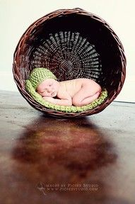 after taking the photo, keep the basket and hang it on the wall using it as a shelf for baby item memrobelia. Place a print out of the photo in the back of it, then when the children get older they can see just how small they used to be!