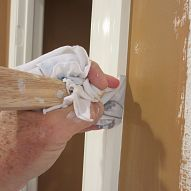 Painting a straight line next to the trim trick How to make a straight line up against the trim with your wall paint.
