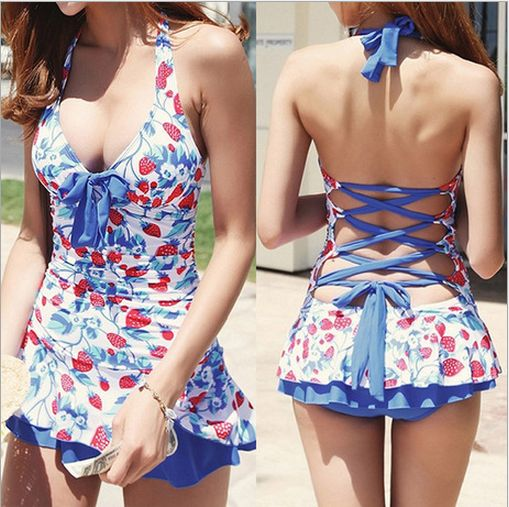 This 1950's Pin Up inspired bathing suit features a halter top, with a lace up corset back, and an adorable little skirt!