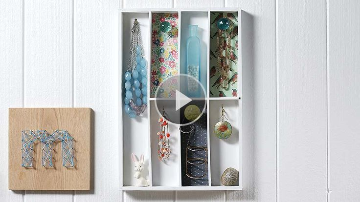 Turn a thrifted utensil drawer into a storage gem for your favorite baubbles. We use paint, decorative paper, and pretty knobs to create this one-of-a-kind display./