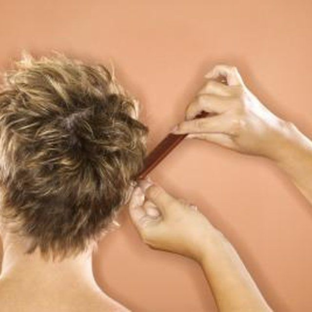 A women's pixie cut is styled to be chic and spiky.