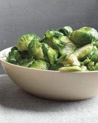 These steamed brussels sprouts are glossed with butter and flecked with chives.