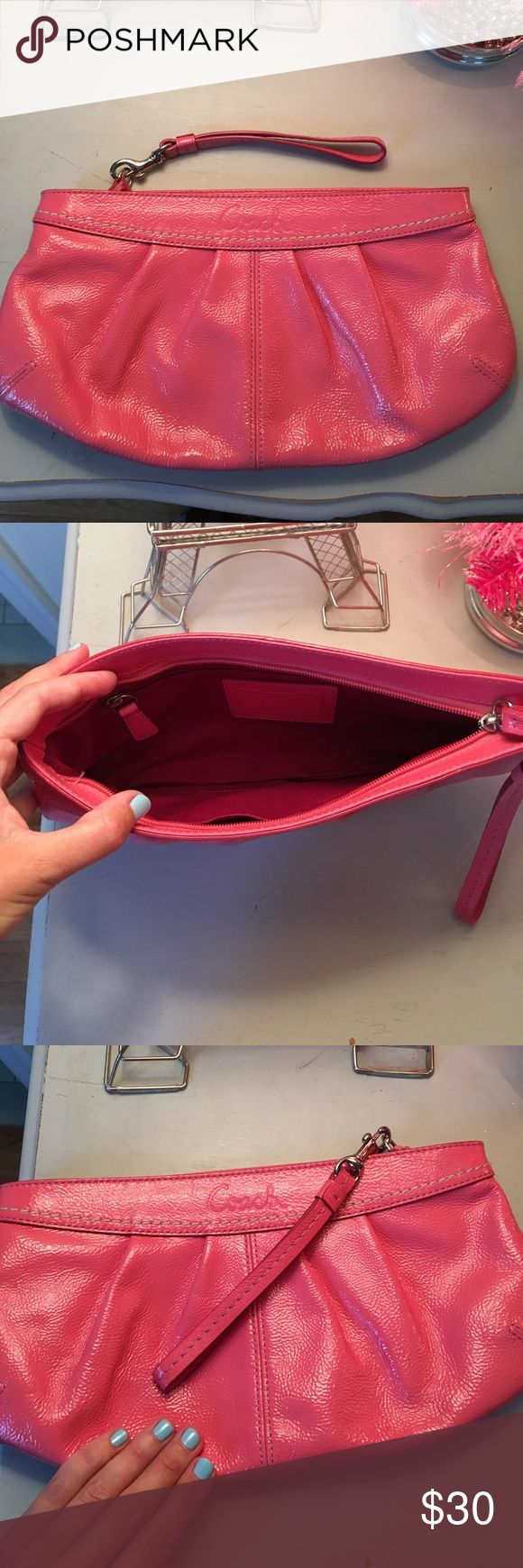 Coral Coach Clutch Small coral clutch, around 12 inches long (sunglasses for scale in picture) Coach Bags Clutches & Wristlets