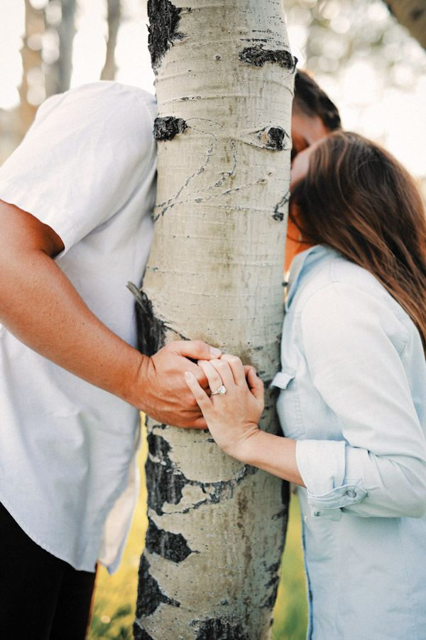 Cute kiss behind and aspen tree showing engagement ring, Utah Wedding Photographer   Park City Engagement Session {Nicole Cooper}   http://www.gideonphoto.com/blog