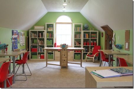 I LOVE this home schoolroom. The color combination (green, white, and red) meshes very well together. It is very organized and cohesive and I love how everything has a place and space.