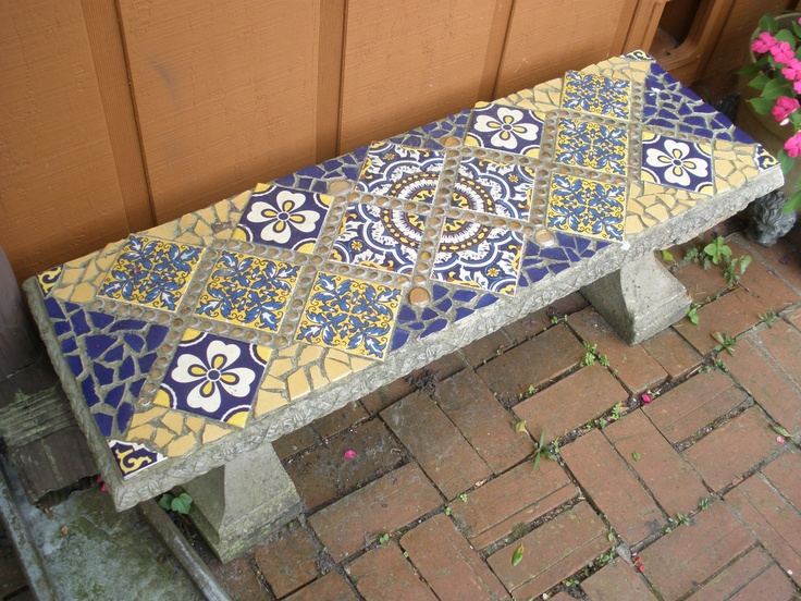 I love this garden bench, I used tiles from one of Chili's tabletops and broken plates.