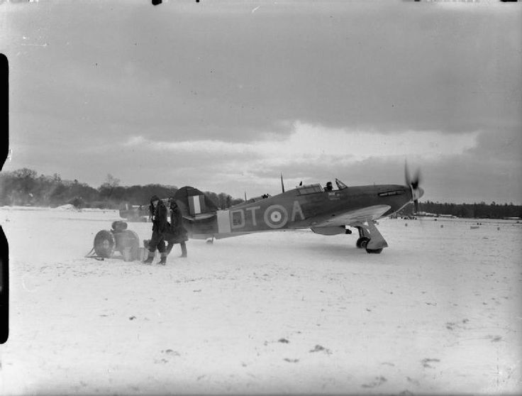Squadron Leader R R Stanford Tuck,Commanding Officer of 257 Squadron RAF, in his Hawker Hurricane Mark I, V6864 'DT-A', prepares to lead a section of Hurricanes to their take-off point, in the snow at Coltishall, Norfolk.A personal hero who had a rough humoured friendship with the irascable Douglas Bader the wirlwind leader with 2 tin legs.He disputed big wings on the extended time they took to form,by which time the damage was usually done.More time to form they devastated formations…