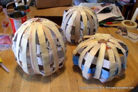 Use a cereal box and paper mache to create 'carveable' pumpkins