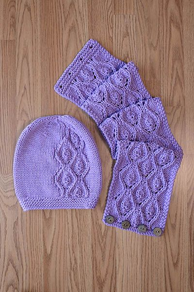 """Idyll Hat and Cowl - free knitting pattern set. Pattern Information Knit in bulky weight Ariana, stitches pop in the flowing lace pattern on this hat and cowl! Idyll Hat and Cowl Designed by Universal Yarn Design Team FINISHED MEASUREMENTS Hat Circumference: 20"""" Hat Depth: 9¾"""" Cowl: 7"""" x 36"""" MATERIALS Universal Yarn Ariana (63% bamboo, 37% polyamide; 100g/91 yds) • 108 Grape – 4 skeins (2 skeins for Cowl, 2 skeins for Hat) Needles: US Size 10 (5 mm) straight or size needed to obtain gauge…"""