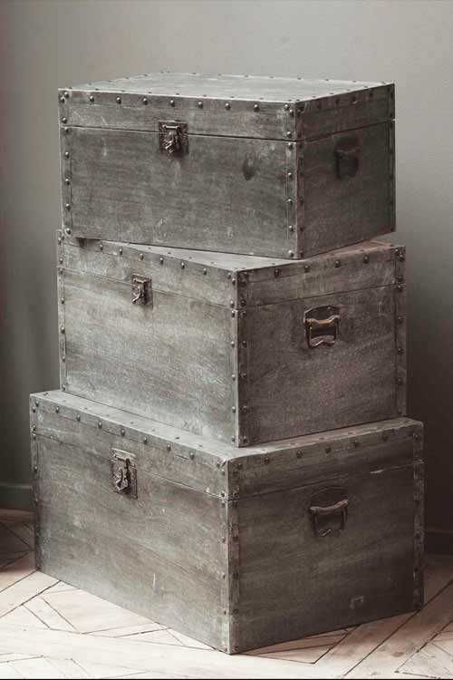 Gorgeous set of trunks covered in distressed metal sheeting #rustic #decor #accessories