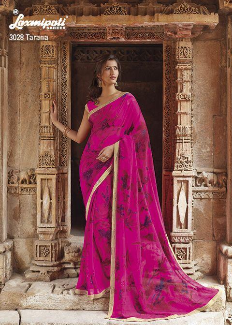 Dark pink flowered printed satin georgette saree & terrific golden border and diamond work.