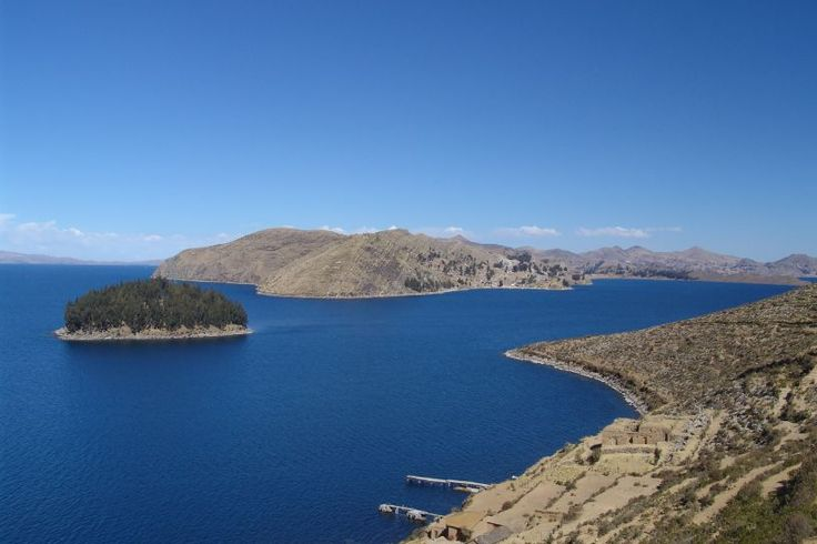 Lake Titicaca Located between Bolivia and Peru, Lake Titicaca is one of the most fascinating lakes in the world. It is situated at a very high altitude, at over 3800 meters above sea level, and a tour at Titicaca is definitely an unforgettable experience for any visitor. When visiting Lake Titicaca, the town of Puno is the best place to stay, on the Peruvian side of the lake.  The town of Puno is an interesting place to visit as it is the capital of folklore of Peru.