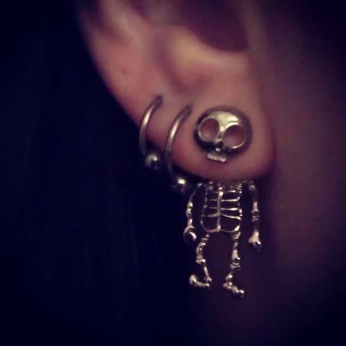 Piercings. Skull earring.
