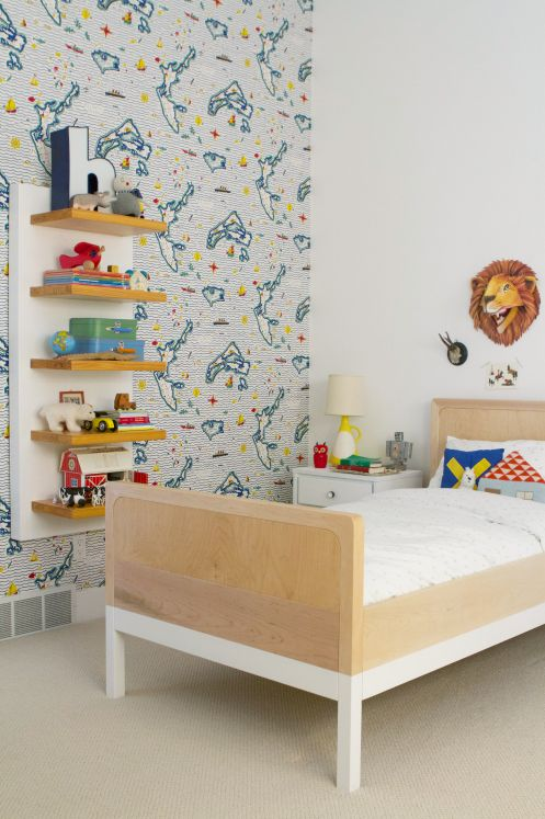 boy's toddler bedroom with map wallpaper