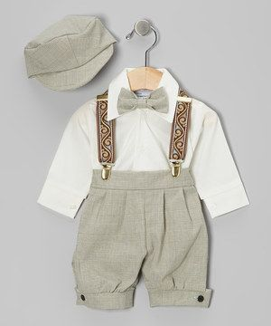 With a fancy collared shirt, classic clip-on bowtie and cool newsboy cap, this sweet set will have little gentleman looking preciously dapper. The elastic waistband on the knickers and sweet suspenders, help top off the ensemble and keep it fitting snug.
