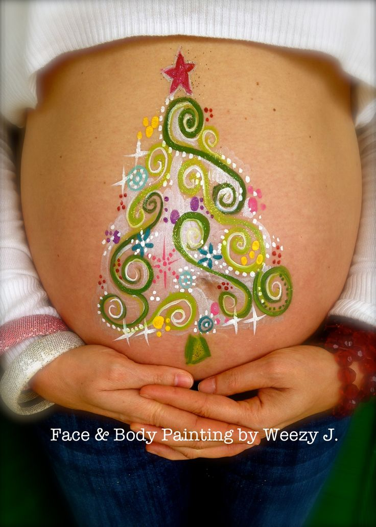 Holiday belly painting.  Pregnant belly painting.  Christmas tree belly art. pregnant belly art. -- This could work as a cheek art design or center element for a crown/mask.