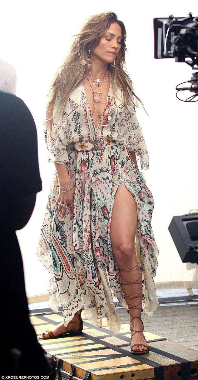 Gorgeous as ever: Jennifer Lopez was clad in a festival-friendly ensemble to shoot her new...