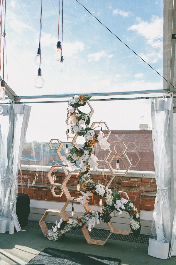 Set the stage with this mod geometric backdrop with bulbs and blooms! www.huskeralum.org/venues