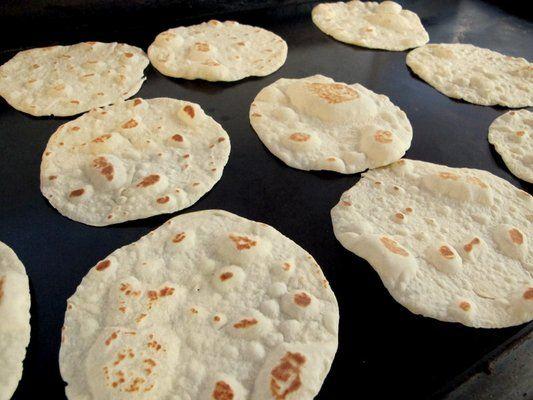 FLOUR TORTILLAS Chevy's Fresh Mex Recipe Makes about 1 1/2 Dozen 6 cups all purpose flour 1 teaspoon baking powder 1/2 teaspoon salt 1/2 cup vegetable shortening, cut in to small pieces 2 1/2 cups warm water