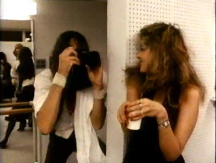 Stevie    ~ ☆♥❤♥☆ ~  fooling around while Mick Fleetwood, takes her photo backstage
