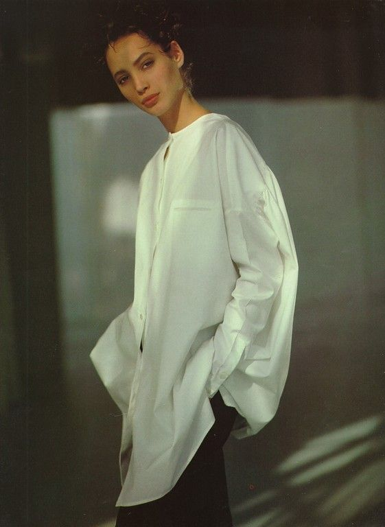 Christy Turlington wearing a simple, asymmetrical button up. Photo by Arthur Elgort.