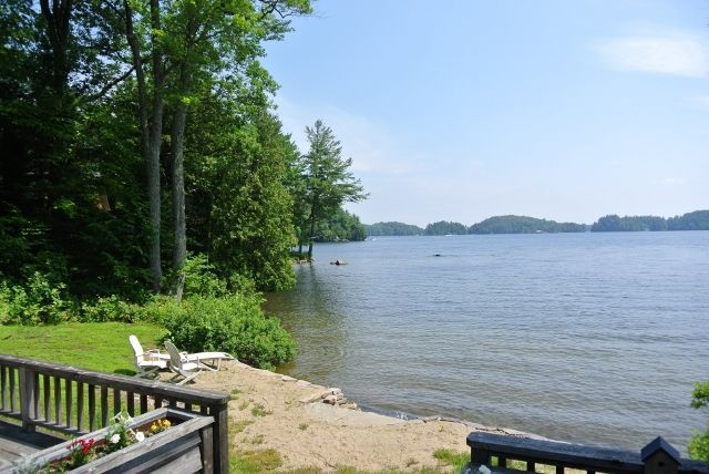 Waters edge #cottage #realestateforsale Sand beach, 3 bed, 3 bath.  #lakerosseau #Muskoka Large 2 slip boathouse, #privacy #waterfront