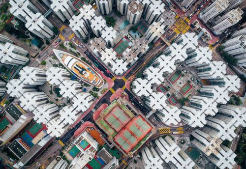 Walled City 圍城In the words of the artist Andy Yeung: The Kowloon Walled City was once the densest place on Earth. Hundreds of houses stacked on top of each other enclosed in the center of the structure. Many didn't have access to air or open space....
