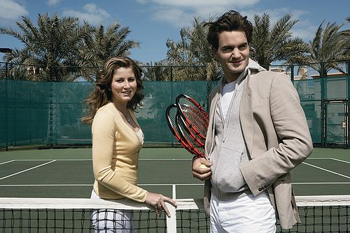 Roger with his almost-literal other half. Seriously, I don't think he could live without Mirka.