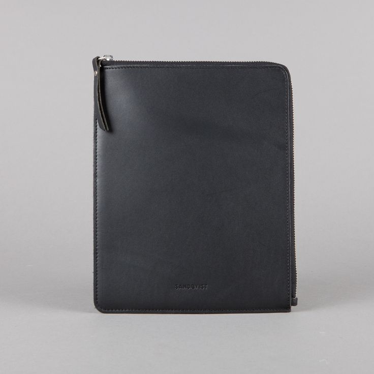 Sandqvist Bengt Ipad Case In Black: A classic and timeless iPad case in black, vegetable tanned leather. Zipper closure from YKK. Grey lining and padding for extra protection Dimensions: 16 x 21.5 cm