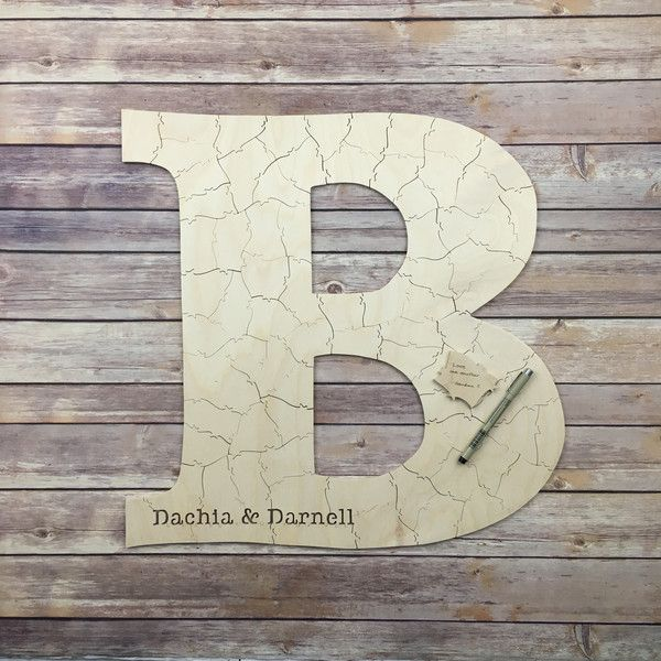 A wedding puzzle guest book made in the shape of a letter. HOW MANY PIECES…