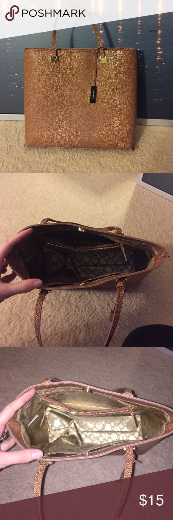 Ivanka Trump Camel Bag Ivanka Trump Camel Bag with satin interior. Sturdy structure. Two thin handles and snap closer. Interior zipper pocket. Ivanka Trump Bags Totes