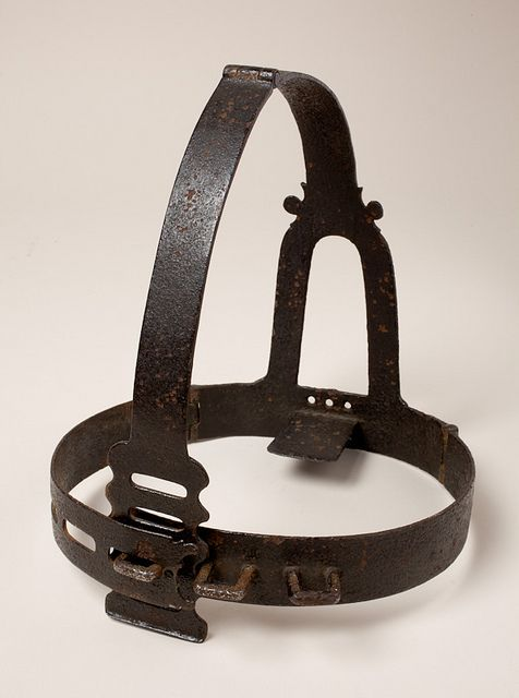A scold's bridle (brank's bridle) was an instrument of punishment used primarily on women, as a form of torture and public humiliation. The device was an iron muzzle in an iron framework that enclosed the head. A bridle-bit (or curb-plate), about 2 inches long and 1 inch broad, projected into the mouth and pressed down on top of the tongue. The curb-plate was frequently studded with spikes, so that if the offender moved her tongue, it inflicted pain and made speaking impossible. Wives who…