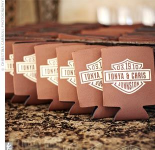 Custom koozies with a Harley-Davidson logo, inscribed with names,  last name, and wedding date.