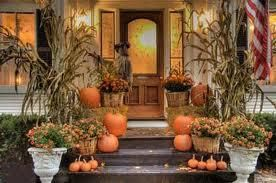 We love this beautiful front porch decorated for Fall.