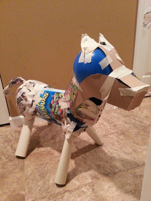 Diy papermache pinata. Horse pinata for pony party. 2 Cereal boxes, 3 balloons & paper towel rolls, masking tape & newspaper to bulk up areas. Next step is to papermache