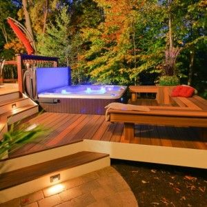 beautiful deck with hot tub featuring built in benches stages and deck lights patio. Black Bedroom Furniture Sets. Home Design Ideas