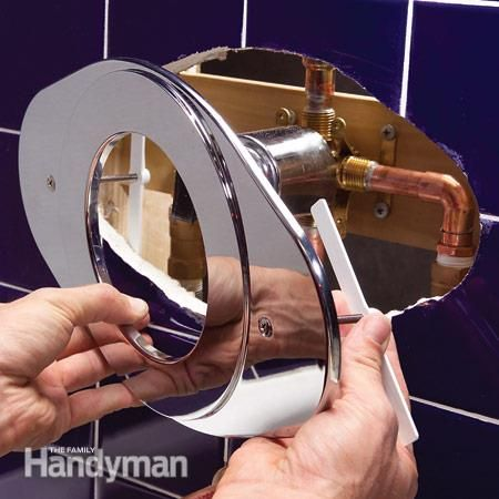 Add the cover plate to complete the shower faucet installation. Shower Faucet Installation: http://www.familyhandyman.com/bathroom/shower-installation/shower-faucet-installation/view-all