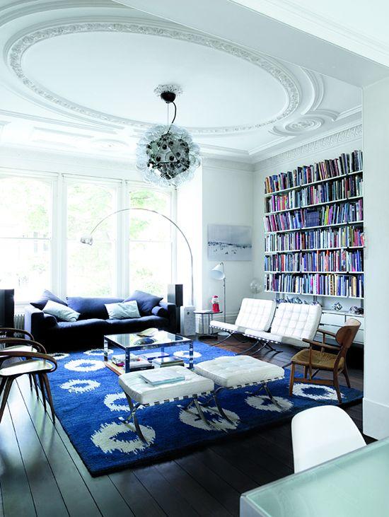 ETC INSPIRATION BLOG ART DESIGN FOOD INTRIOR LOND HOME LIVING ETC BLUE RUG BLUE SOFA COLORFUL BOOK BOOKSHELF WHITE LEATHER SILVER LAMP BRIGH...