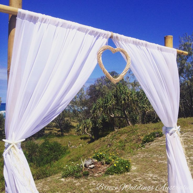 Simple elegant bamboo arch with starfish and wicker heart. Styling by www.breezeweddings.com.au #breezeweddings #bambooweddingarch #twopost #wickerheart #starfish #cabarita #beach #foreshore #weddingceremony #lovemyjob #weddingstyling #ideas #бамбуковая #свадебная #арка #напобережье #свадьба #идеидлясвадьбы #свадебный #стилист #любимаяработа #diy