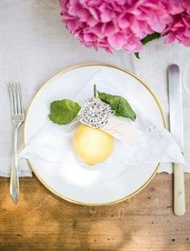 """For each place setting, I plucked a lemon from the orchard, tied a name tag to it and pinned a vintage brooch to it, which the girls also pinned to their bouquets the day of the wedding."" - Bridal Luncheon With Samantha Hutchinson Of Could I Have That? 