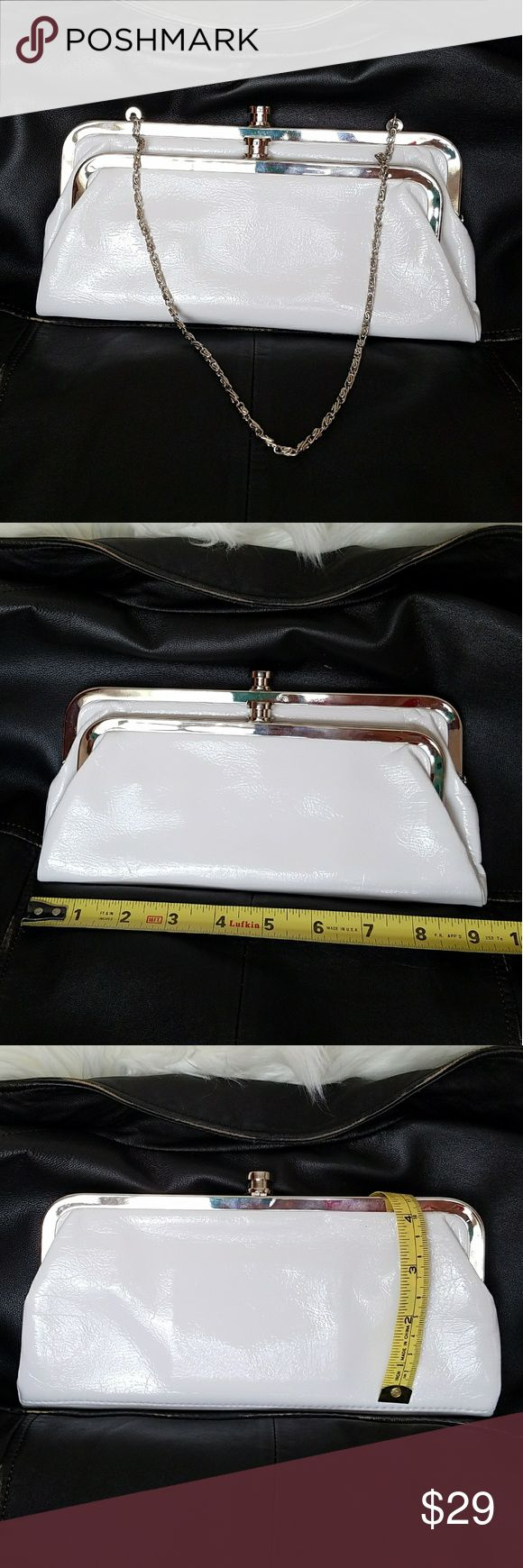 """Patent leather evening bag White House Black Market white patent leather evening clutch with hidden metal chain strap. Two separate bauble snap close sections. Hidden magnets close the two sections together. 9"""" x 4.5"""" and 3.5"""".  Used once, EUC, no stains, marks or damage on the inside or outside.  Smoke free home White House Black Market Bags"""