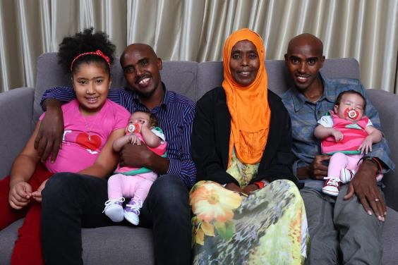Olympic gold winner Mo Farah with wife and twin daughters. along with his twin brother, Hassan and his wife.