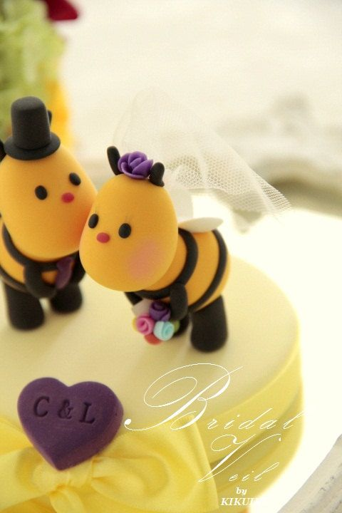 Sweety  Kissing  Bees bride and groom wedding cake topper. $110.00, via Etsy.