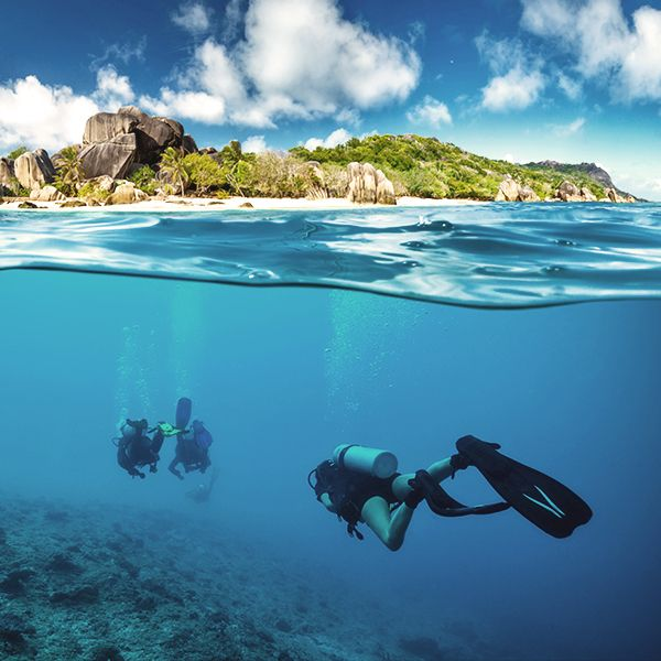 Seychelles - Sandy white beaches and crystal blue waters.