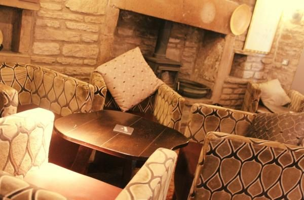 Lounge area with cosy woodburner at the Dusty Miller Inn & Coiners Restaurant, Mytholmroyd. www.iknow-yorkshire.co.uk