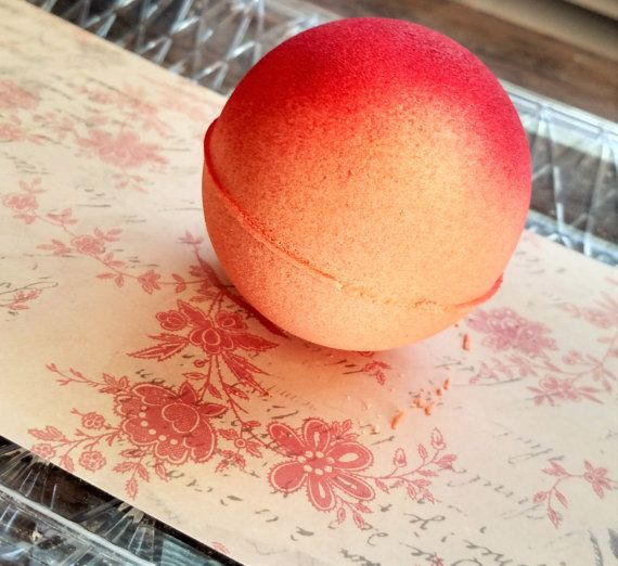 Sunrise Mango/Grapefruit bath bombs, are a crisp, fruity citrus smell that is refreshing yet sweet. Bright bath bomb makes a great gift for anyone who loves the scent of citrus and mango. Orange bath fizzy has a splash of red lake, that will remind you of a beautiful sunrise, and leaves your bath a pretty peach color in the end.  Sunrise Bath Bomb medium size (8 inches around). To enjoy simply run your bath to desired temperature, drop in the bath fizzy and enjoy :)  *Natural Fragrance Oil…